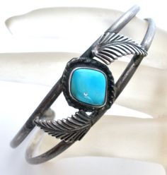"""Handmade Jewelry 925 Bracelets - This is a sterling silver cuff bracelet with a leaf design and blue turquoise gemstone center. It is almost .63"""" wide, weighs 10.3 grams, inside circumference 5"""", and"""