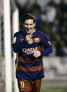 Barcelona's Argentinian forward Lionel Messi celebrates after scoring during the Spanish league football match CF Rayo Vallecano vs FC Barcelona at the Vallecas stadium in Madrid on March 3, 2016.