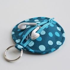 The perfect stocking stuffer... Circle Zip Ear Bud Pouch sewing tutorial by Dog Under My Desk