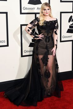 """We know Meghan Trainor for her penchant for poppy pastels, but we're loving this darker side of her personality as well. This olive Galia Lahav dress with a black, sheer overlay — polished off with Simon G. jewels — is positively majestic. And, all together now: """"We're all about that lace, 'bout that lace..."""""""