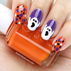 "A final look at my Hallowe'en manicure. Maybe the ghosts are actually screaming, ""Roarrrrange!""  It's the Essie nail polish I used for my Hallowe'en nail look yesterday, which is featured on SwatchAndLearn.com today! (Clickable link in profile.)"