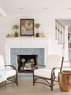 white room with pale blue tiled fireplace