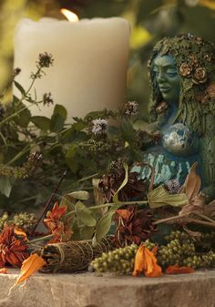 Altar to Gaia - I love this statue.  She's been on my altar for years.