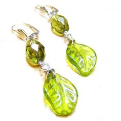 """Type of Jewelry: handmade silver dangle earrings    Metal: silver plate    Material: silver plate lever back ear wires, green glass briolette bead, 18x12mm green faceted glass bead    Stone: none    Main color: green    Length: 2""""inches    Item condition: brand new    Jewelry style: handmade jewelry design"""