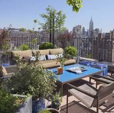 HGTV features an urban NYC patio lounge with a stunning city view and bright blue patio table. Outdoor Rooms, Outdoor Living, Outdoor Furniture Sets, Outdoor Decor, Rooftop Lounge, Rooftop Terrace, Greenwich Village, Porches, Outdoor Stone Fireplaces