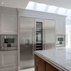 Gaggenau Vario fridge, wine cooler and freezer with combination ovens and warming drawers below | WOW