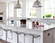 """Kitchen Design, Kitchen Designer in Bath and Wiltshire, Stephen Graver. """"Featuring a large kitchen and dining area, big enough for a large dinner party, this kitchen has classic clean lines with a timeless feel.  The centre piece is the island, perfect for informal eating.  Hand painted on site and fitted with American pull handles. The finishing touch is the 50mm thick marble work surface, to give a feel of pure indulgence."""""""