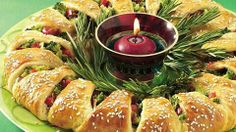 "Easily transform crescent rolls into a festive first course for 16. Wrap red and green veggies inside and decorate with fresh rosemary ""greenery."" It's a beautiful edible centerpiece!"