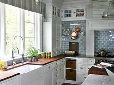 ~  The Kitchen Designer ~ The island has mix of wood and marble counters ~ love the cabinets sitting on the counter