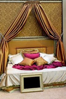 Bohemian Bedroom Canopy calligraphy textile as bed canopy, lv louis vuitton trunk in