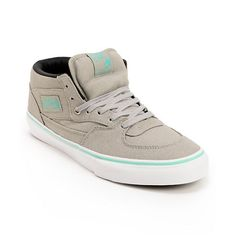 The Vans Half Cab shoe is an all time classic and what better way to rock an icon than to slip on these Grey and Seafoam Half Cab skate shoes. This Half Cab model has a cool canvas upper for lightweight skate performance. Double stitched, a padded collar and tongue, and Vans one and only vulcanized out sole optimize comfort and durability for you while you are ripping through the streets or your local skate park mini ramp in these sick Grey Vans . With a custom sea foam mint like green on…