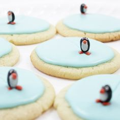 Create mini ice skating rinks for penguins with frosted sugar cookies and black jellybeans.