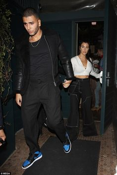Getting serious?: Kourtney and Younes, 24, were hand in hand on Thursday at Kendall Jenner...