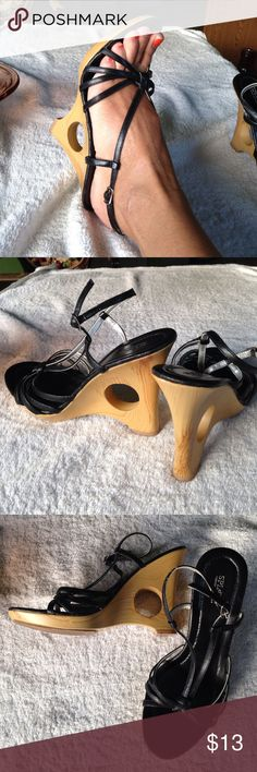 "9 Splash Faux Wood Hole Wedges You can't tell these aren't real wood soled sandals, nice quality. 4 1/2"" heels, black strappy heels make you sky high and make your feet look tiny. Definitely date night! Splash Shoes Sandals"