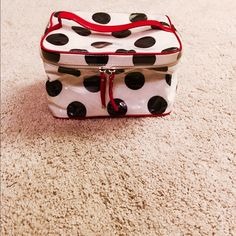 "KATE SPADE Polka Dot Cosmetic Bag Purchased from Bloomingdales this Kate Spade cosmetic bag is in ""like new"" condition. The perfect bag, it fits all your makeup and toiletries for traveling and weekend getaways!     OFFERS WELCOME ⚪️ kate spade Bags Cosmetic Bags & Cases"