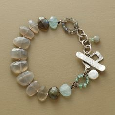 """CALM BEFORE THE STORM BRACELET--Clouds of moonstone and labradorite burst into a flurry of design elements: gemstone ringlets, danglers and a cultured coin pearl near a prominent sterling silver toggle clasp. Handmade exclusive. 7-1/2""""L."""