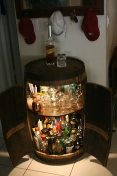 Whiskey barrel bar cabinet, I wonder if I can make this into a cigar humidor? (Or, have one for cigars. Drinks Cabinet, Liquor Cabinet, Whiskey Barrel Bar, Wine Barrels, Tonneau Bar, Alcohol Cabinet, Barris, Barrel Projects, Bar Cart Decor