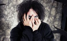 The Cure's Robert Smith forced to perform solo set after band's equipment fails - video | News | NME.COM