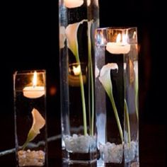 Wedding center piece, but with mason jars and maybe some berries.  I like the floating candle on top.