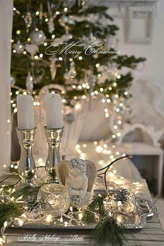 Christmas table setting with candles. Xmas Silver tree