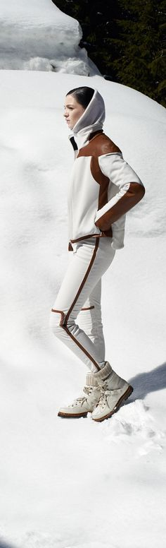Hermès - Vestiaire d'Hiver 2013. Ski jacket and tapered trousers in chalk-white stretch canvas with caramel calfskin details, snow boots in white calfskin. #hermes #fashion #skiwear
