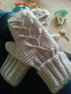 Post stitches and bobbles pop against a smooth, extended single crochet background. A nifty technique with the traveling cable stitches eliminates the holes that can happen with cables, so your mittens are cozy all over.