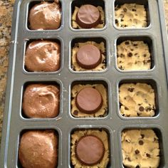 Preheat oven to 350; smoosh 1.5 squares of break-apart refrigerated cookie dough into the bottom of each well. Place Reese cup upside down on top of cookie dough (or an Oreo). Top with prepared box brownie mix, filling 3/4 full. Bake for 18 minutes.
