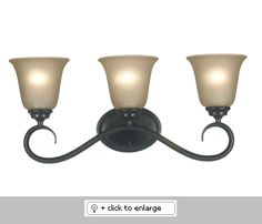 """Helena 3 Light Vanity Bathroom Light   6 Inch Diameter Amber Glass Shades    A warm bronze patina deepens and enriches the classic, yet contemporary style.    Sconce and Vanity Can Mount Up or Down  Dimension: H. 10-9/16"""", W. 23=3/8"""", Ext. 7-9/16""""    Bulb: 3-100 Watt (M) Bulbs    Finish: Bronze Patina Finish  Regular price: $118.00  Sale price: $100.50"""