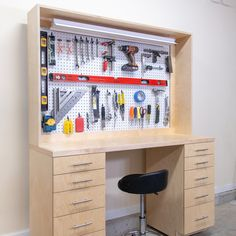 Build a workbench for your garage workshop for your DIY projects.  This DIY workbench is a great place for small projects like electronics, carving, planning, or small repairs.  The 5 drawers add workshop storage where you need it and the pegboard tool wall keep your most used tools handy.  See the full video and available plans! #workbench #garageworkshop #workshopstorage #garageshop #workshoporganization