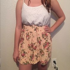 Pink Floral Patterned Skater Skirt Light pink skater skirt with rose flower pattern. Buttons in the front, back of waistband is elastic. 47% linen, 45% rayon, 8% cotton. Barely worn, in great condition! Forever 21 Skirts Circle & Skater