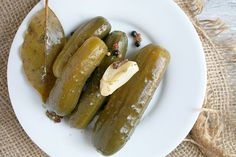 """A Simple Recipe for Homemade Natural Fermented Pickles 24 (or so) small 4""""-5"""" pickling cucumbers 6 cloves garlic, ends removed and smashed 6 bay leaves 2 1/2 tbls pickling spice(cloves, coriander..."""