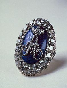 Ring with the Monogram of Tsar Alexander I, circa Early 19th century.  Gold, silver, cut and uncut diamonds, enamel; chased and polished. 2.2-3.4 cm.
