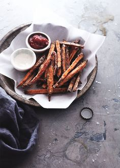 Baked Sweet Potato Fries With Sweet Potatoes, Olive Oil, Corn Flour, Salt, Pepper, Spices, Greek Yogurt, Honey, Ground Cinnamon