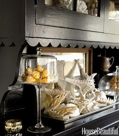 An assortment of shells adds a natural element to the breakfast room. Karyn R. Millet  - HouseBeautiful.com