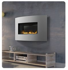"""A modern gas fireplace that hangs on your wall. Ideal for modern and contemporary rooms, the Napoleon Plazmafireâ""""¢ 31 Gas Fireplace features easy installation plus all of the conveniences of a gas fireplace. Classic Fireplace, Small Fireplace, Fireplace Mantle, Fireplace Ideas, Contemporary Gas Fireplace, Direct Vent Gas Fireplace, Brick Paneling, Modern Style Homes, Houses"""