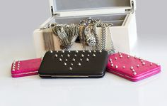 Studded clutch. Would be easy to make without buying this kit. Studs are sold are craft stores and these clutches at Target and Walmart.