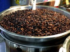 Roasted silkworm larvae on Jarong Road in South Korea. Tastes better than it looks and packed with protein!