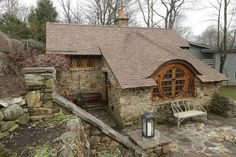 Stone house with Irish or Hobbit style wood windows doors and accents