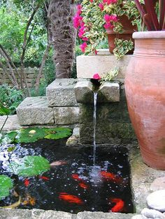 "I would love to have a pond ""in"" the patio area that I could have a few koi fish in!! Small-Garden-Pond block waterfall"