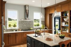 Like the contrast of the black island with honey oak cabinets