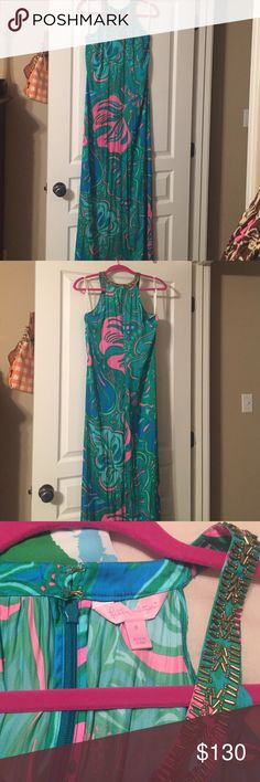 Lilly Pulitzer Franconia maxi dress Lilly lounge print. Gorgeous maxi dress that could be worn to a formal event. Would love to trade for a 10 or 12. Never worn by me. It has been hanging in my closet for 2 years. Has tiny spot on fabric as shown in last picture. I haven't tried cleaning but it's not noticeable. Lilly Pulitzer Dresses Maxi