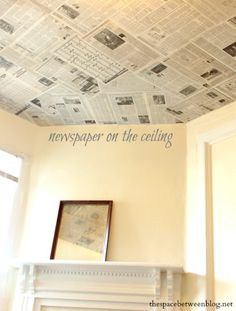 looking for an inexpensive, creative wall covering?  use newspaper, book pages or even old maps to wallpaper your walls or ceiling.  This is a six dollar upgrade that took less than 3 hours!