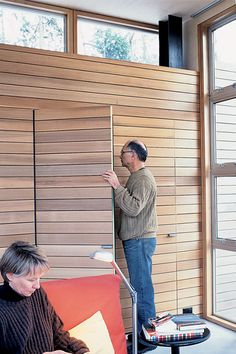 """Lightweight, non-toxic Italian poplar siding covers a disappearing closet door in a Washington house. """"The Seattle Opera uses it for stage sets, and the lumberyard carries a large amount of the product to outfit them,"""" says resident Anthony Pellecchia. Lite-Ply is about half the weight of conventional siding and can be fastened by staples."""