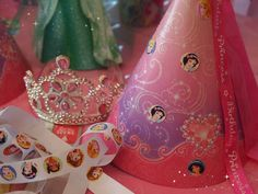"Thinking about picking out some beautiful craft paper and creating the cone shaped princess ""crown"" with streamers and stickers"