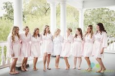 The bride and her bridesmaids share a fun moment before getting into their dresses. Hair by @Daniel Island Salon Makeup by @dannonkcollard Wedding coordination and design by @charlestonevent