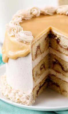 Snickerdoodle Caramel Layer Cake - This elegant triple layer cake is just dripping with caramel sauce and tastes like a your favorite snickerdoodle cookies. Perfect for parties all year round, but really delightful during the fall and winter months with the warm, sweet smell of cinnamon and caramel. This would be a great sweet treat for a fall festival or party. You can serve it at a casual gathering or as a beautiful dessert at an elegant dinner party.