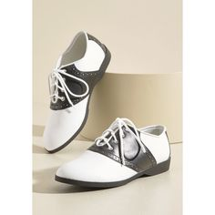 Who Could Be Saddle? Shoes ($39) ❤ liked on Polyvore featuring shoes, low heel shoes, sport shoes, black and white flat shoes, black and white oxford shoes and flat pumps