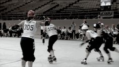 """A major sign of of high-level derby: """"Don't quit until you're out of play, even if you think your teammate has it under control."""" Scald Eagle delivers a huge hit to the blue jammer, but goes out of bounds in the process; instead of letting her run away, #108 Fifi Nomenon skates over to the boundary to catch her, hits her hard enough to knock her out on the inside, and then she and Scald run the jammer back together."""