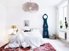 Room Fit for a Teen - Cozy and bright Scandinavian bedroom with Gustavian clock and white floorboards.