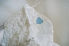 something blue. heart made out of bride's deceased grandfather's shirt, sewn into the inside of her wedding dress so she could have a part of him with her on her wedding day.  photo by Heidi Ryder Photography